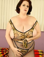 Damn hot BBW in that fishnet body suit and stockings gets ready for buckwild mandigo sex