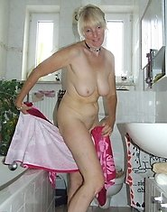 Kinky housewife taking a naughty shower