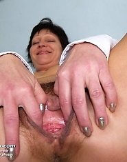 Mature head nurse Eva dildoing her hairy pussy at gyno office