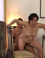 The granny whore is horny for a big cock meat and the young man fills her up