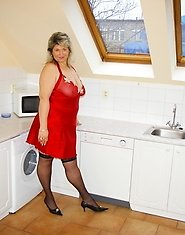 Chunky big boobed mature slut playing in the kitchen