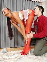 Sweltering French maid in red stockings kneeling down to swallow hard cock
