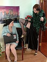 Black-stockinged lady-boss going down on her attractive nyloned assistant