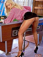 Helle spreads on top of pool table