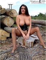 Busty Brunette Babe In Tan Stockings And Basque Outdoors