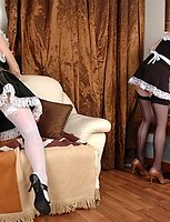 French maids in silky stockings taking a break for lez play with a strap-on