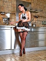 Voluptuous French maid in see-through uniform and barely black stockings