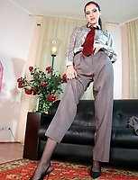 Business woman in soft nylons stripping her trousers taking out her dildo