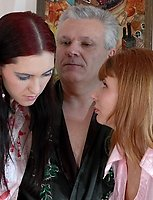 Stockinged brunette and redhead teasing old man with hot lesbian nylon show