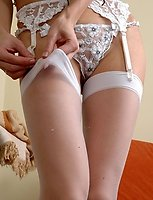 Well-shaped chick prefers her white full-fashioned stockings to red ones