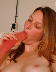 Mature slut playing with toys all day long