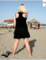 Natasha Speads Her Pantyhose Clad Legs On The Beach With No Panties