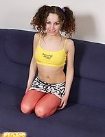 Adorable skinny cutie in red tights shows her pink