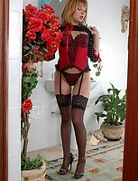 Dazzling French maid in red-n-black uniform with matching black lacy nylons