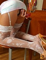 Upskirt gal in extraordinary white patterned stockings going for dildo play