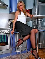 Dressed to kill chick in contrast sole stockings posing sexy on the stool