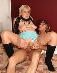 Her wet granny pussy is filled by him on that nice clean hotel bed and she loves it
