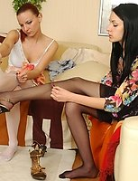 Lesbo girls kick off high heels to put on new sheer stockings and make love