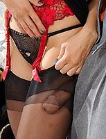 Lascivious babe getting messy cumshot right on her black elegant stockings