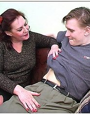 A mature brunette in red stockings is fucked by a blond guy
