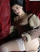 Brunette in white fishnet tights shows her pink