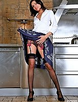 Vivacious chick stripping up to her black back seam stockings and garter