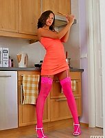 Mischievous babe getting out of control posing in her bright pink stockings