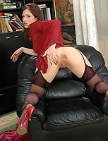 Lascivious gal in expensive black stockings having time to play dildo games
