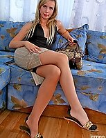 Salacious chick in contrast top full-fashioned stockings having fun in bed
