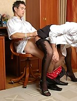 Lusty secretary in fishnet patterned stockings jumping on throbbing cock