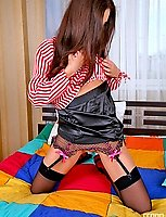 Frisky chick putting off her skirt while teasing with her back seam nylons