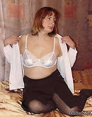A mature blond takes of her clothes and pantyhose