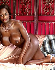 Ebony fuck doll with huge tits fucks toy