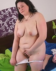 Chubby housewife caught playing on her bed