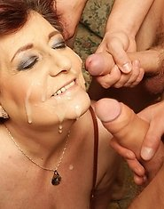 Two mature sluts take on a whole bunch of cocks
