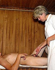 A mature blond masseuse sucks for a younger guy