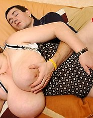 Stacked mature fatty in red thigh highs giving younger guy a special treat