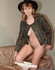 Sexy mature teacher posing nude with a hat on
