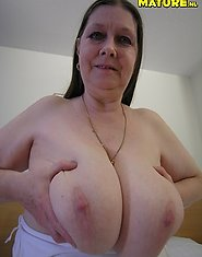 Big titted mature slut showing her stuff