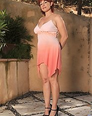 Redhead Calliste taunts us with her natural milf beauty outdoors
