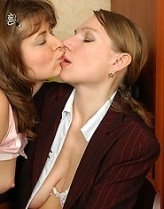 Heated business woman and French maid working with their hands and tongues