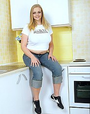 Heavy chested blonde spreads in kitchen